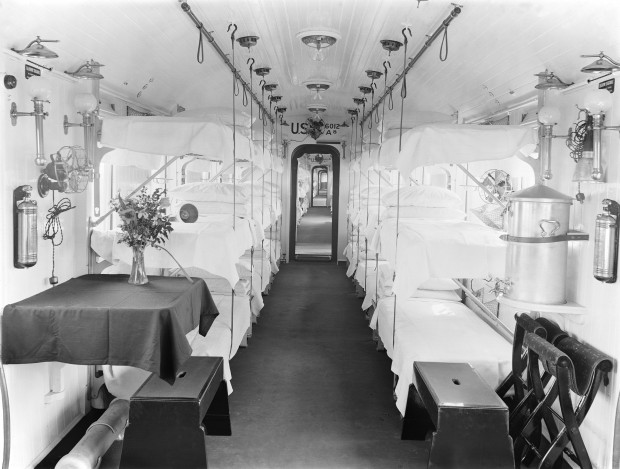Inside an ambulance train in April 1918 – the surroundings are almost luxurious, although the noses of those on the top of the three bunks must almost have touched the ceiling