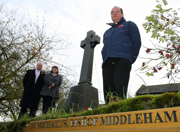 The Rev Michael Gobbett, parish clerk Paul Gray, and Julie Hall, chairman of Bishop Middlemam Parish Council, pictured at the Memorial in the grounds of St Michael's Church