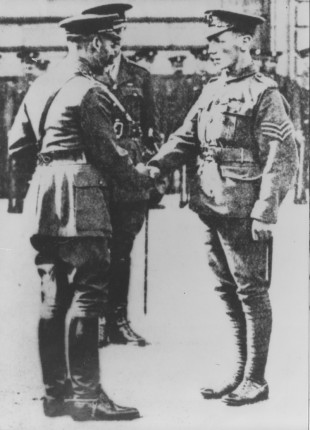 Sergeant Cooper receives his Victoria Cross from King George V