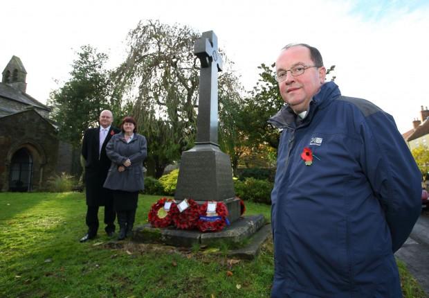 The Rev Michael Gobbett, parish clerk Paul Gray, and Julie Hall, chairman of Bishop Middlemam Parish Council, beside the war memorial at St Michael's Church